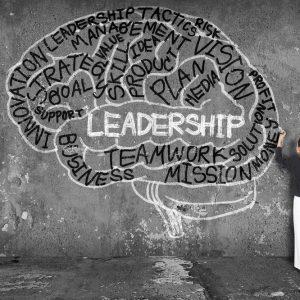 woman writing leadership with brain on wall M